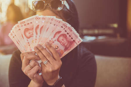 Hands woman counting 100 Chinese Yuan banknote,Close up