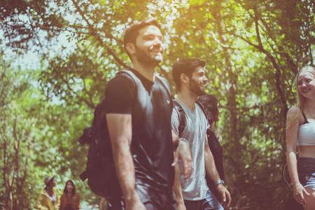 Group of traveler best friends walking together at rain forest,Enjoying backpacking concept Foto de archivo - 133744033