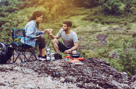 Couple lover cooking food for dinner outside tent together,Enjoying camping concept Foto de archivo - 133744067