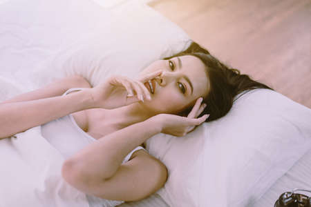 Portrait of young pretty asian women lying down on bedroom,Sexy female and perfect skin,Close up face Zdjęcie Seryjne