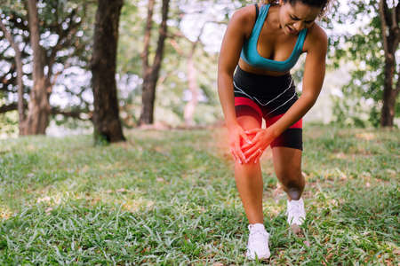 Sporty black women suffering on her knee,Athlete female having pain with legs Standard-Bild