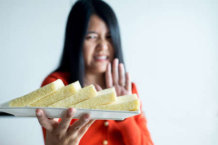 Woman hands refusing white bread,Female having allergy to bread,Food intolerance defined concept