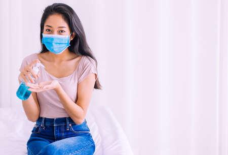 Asian woman using sanitizer hand gel in pump bottle for hygiene coronavirus protection