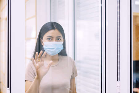 Asian woman stay at home during coronavirus and covid-19 epidemic or pandemic,Social distancing concept