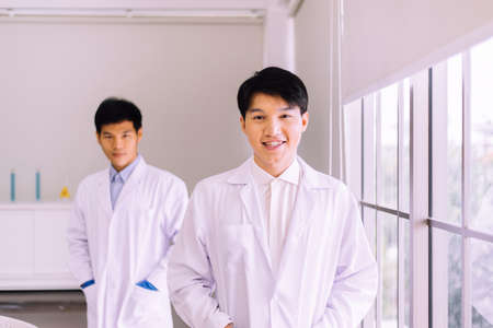 Asian men scientist smiling face and working in hospital,Professional medical teamwork