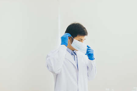 Man doctor or scientist wearing surgical mask for protective coronavirus