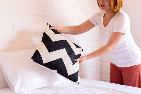 Make a bed,Woman hands making her bed in room after wake up in the morning