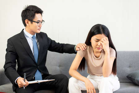 Psychiatrist man talking and counseling to woman patient,Suicide prevention,Mental health care concept,World mental health day Stock Photo