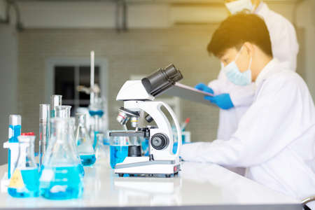 Microscope with metal lens for research and medical equipment in laboratory Stock Photo