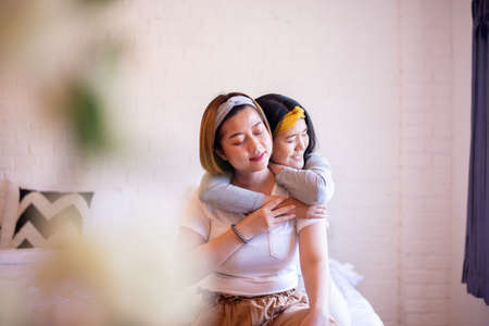 Two asian woman hugging in bedroom together,Happy and smiling,Lesbian,LGBT