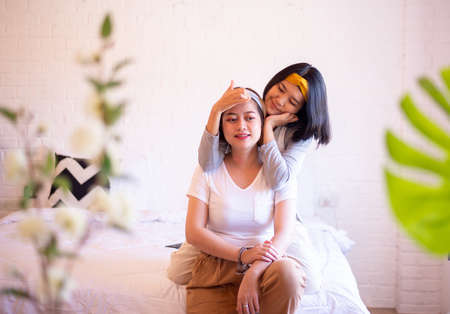 Two asian woman relaxing in the bedroom together,Happy and smiling,Lesbian,LGBT Stock Photo