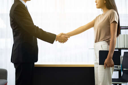 Business asian people shaking hands finishing up meeting,Happy partnership,Handshake for business deal Imagens