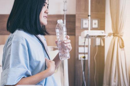 Asian women patient having or symptomatic reflux acids at hospital,Gastroesophageal reflux disease,Drinking water