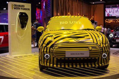 NONTHABURI, THAILAND - March 25,2021 : View of MINI ELECTRIC - Full Electric Hatchback yellow color on display at Thailand International Motor Show 2021, exhibition of vehicles for sale in Nonthaburi,Thailand Editorial