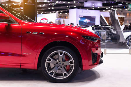 NONTHABURI, THAILAND - March 25,2021 : Side view of Maserati Levante red color on display at Thailand International Motor Show 2021, exhibition of vehicles for sale in Nonthaburi,Thailand