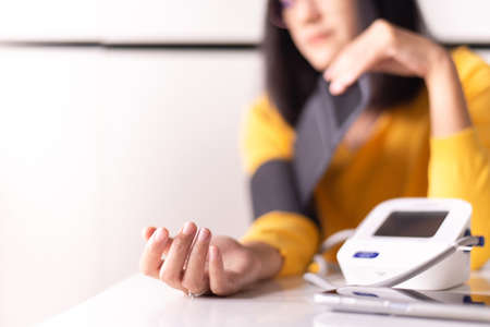 Women using blood pressure & heart rate monitors in yourself at home