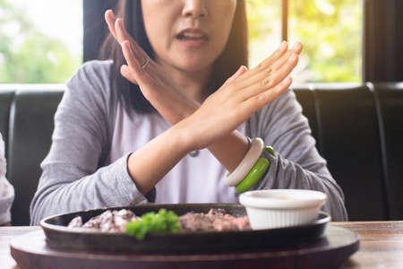 Hands woman refusing food in restaurant,No meal,Diet food concept