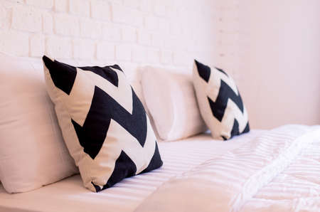 Image of pillow and new design modern bedroom interior decoration at hotel Imagens