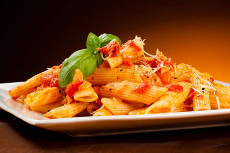 Pasta with tomato sauce and parmesan Stockfoto