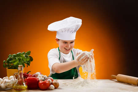 Boy making pizza dough photo