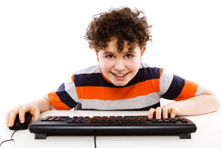 Boy using computer isolated on white background Stock Photo - 10672012