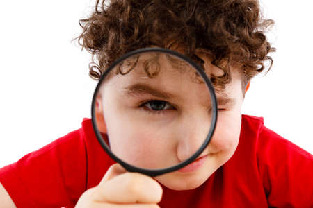 inspector kid: Boy looking through magnifying glass isolated on white Stock Photo