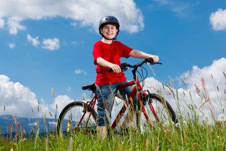free riding: Cyclist - boy riding bike Stock Photo