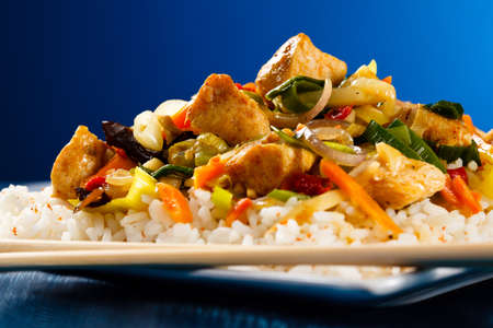 Asian food - chicken with vegetables and rice photo