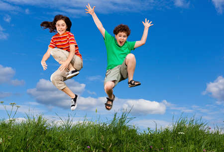 happy people jumping: Girl and boy jumping outdoor