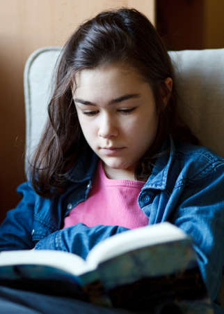 Girl reading book photo