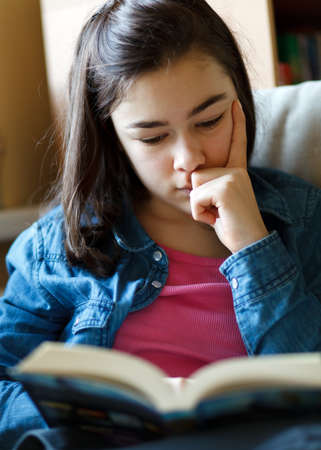 reading room: Girl reading book Stock Photo