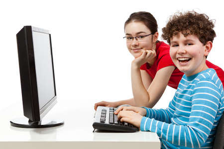 Girl and boy using computer isolated on white background photo