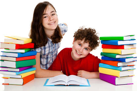 Students sitting behind pile of books on white background Stock Photo - 12049863