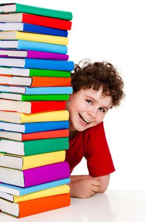 peep: Student sitting behind pile of books on white background Stock Photo