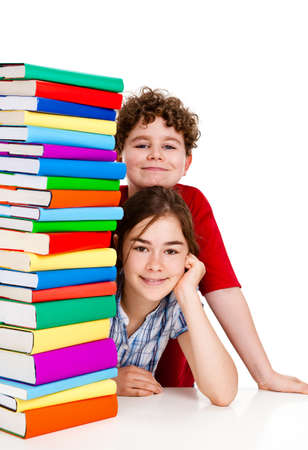 peek: Students sitting behind pile of books on white background