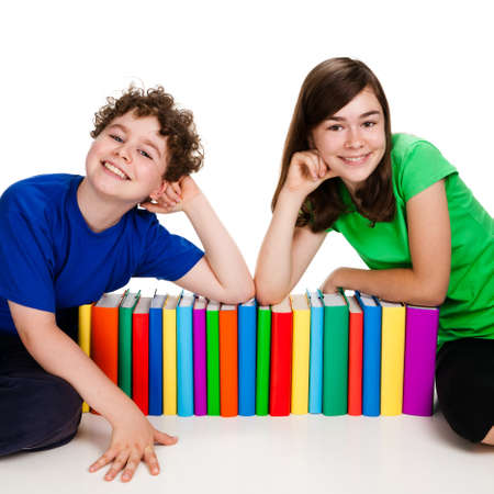 Kids behind pile of books isolated on white background photo