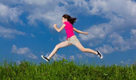 hopping: Girl jumping, running against blue sky