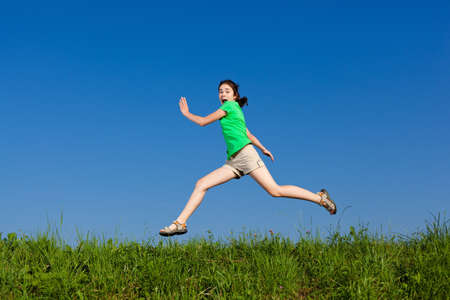 Girl running, jumping outdoor photo