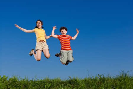bouncing: Girl and boy running, jumping outdoor