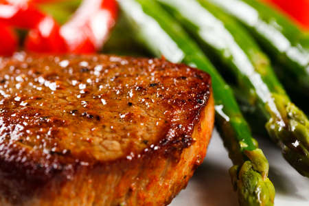 Grilled steak and asparagus photo