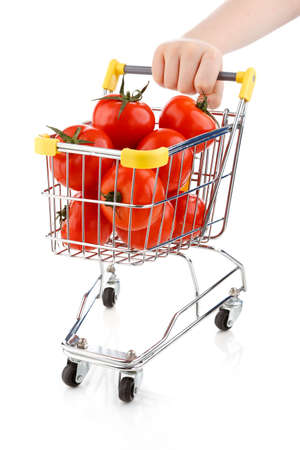 Shopping trolley full of tomatoes on white background photo