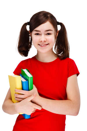 13 14 years: Girl holding books isolated on white background Stock Photo