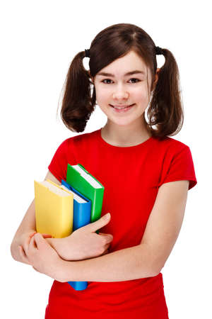 13: Girl holding books isolated on white background Stock Photo