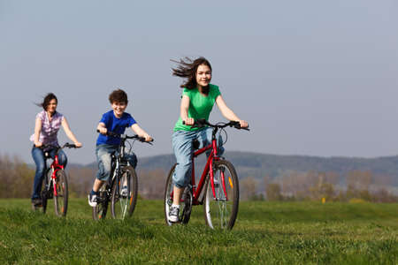 bicyclists: Family riding bikes