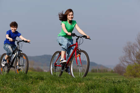 Girl and boy riding bike  photo