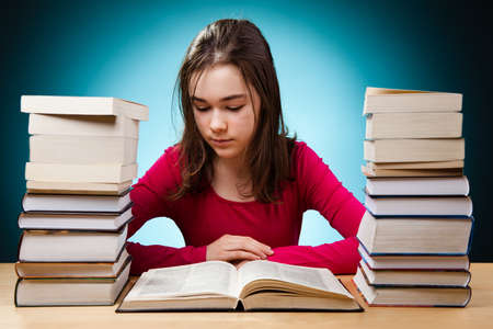 13: Girl reading book Stock Photo