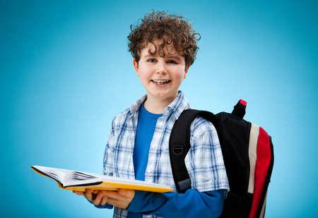 Boy reading book photo