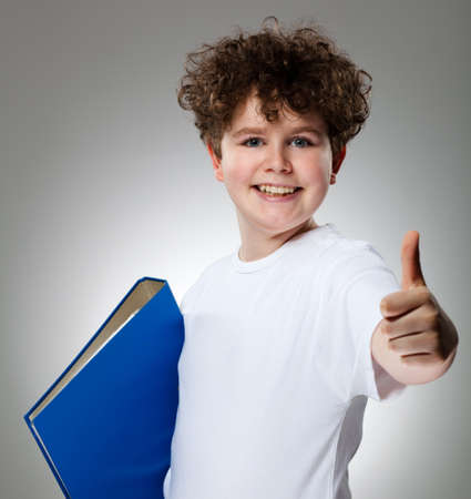boy book: Student showing OK sign on gray background Stock Photo