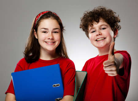Girl and boy showing OK sign photo