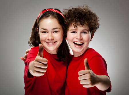 Girl and boy showing OK sign Stock Photo - 13684307